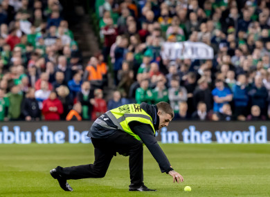 A steward removed a tennis ball from the Aviva Stadium pitch on Tuesday night.