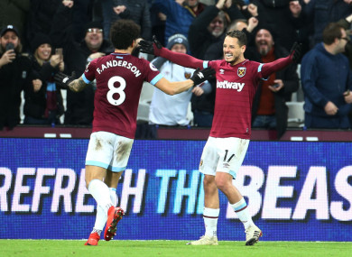 Javier Hernandez scored two late goals to earn West Ham the win over Huddersfield.