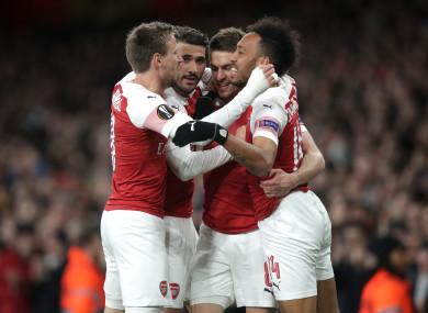 Arsenal players celebrate Ramsey's goal.