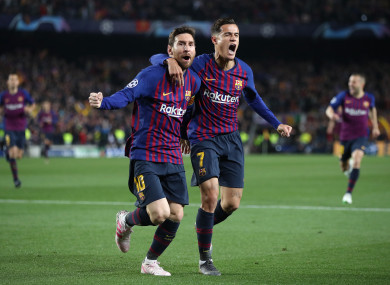 Lionel Messi and Philippe Coutinho celebrate.