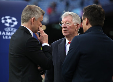 Manchester United manager Ole Gunnar Solskjaer, Sir Alex Ferguson, and Gary Neville talk before last night's match.