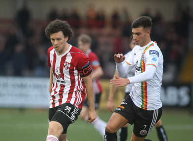 Barry McNamee and Danny Mandroiu battle for the ball.