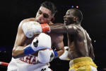 Terence Crawford, right, punches England's Amir Khan during the fifth round.