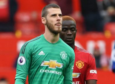 A dejected David De Gea leaves the Old Trafford pitch at half-time.