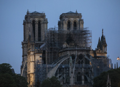Notre Dame fire: Investigations focus on construction work as world ...