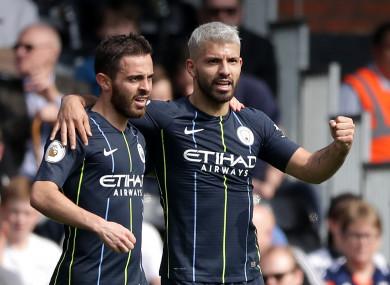 Manchester City's Sergio Aguero and team-mate Bernardo Silva celebrate.