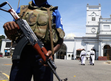 A guard near St Anthony's Shrine in Sri Lanka, where one of eight bombs exploded last Sunday.