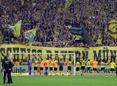 Dortmund fans unfurl a banner reading 'Scheisse Bayern Munich'