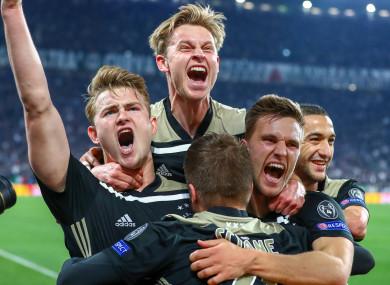 Ajax players celebrate.