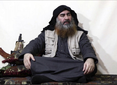 This image made from video posted on a militant website purports to show the leader of the Islamic State group, Abu Bakr al-Baghdadi, being interviewed by his group's Al-Furqan media outlet.