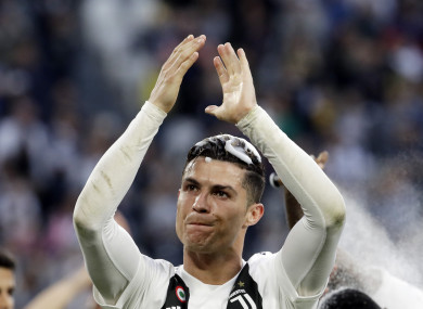 Ronaldo celebrates Juventus' title win on Saturday in Turin.