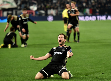 Daley Blind celebrates after a stunning win over Juventus.