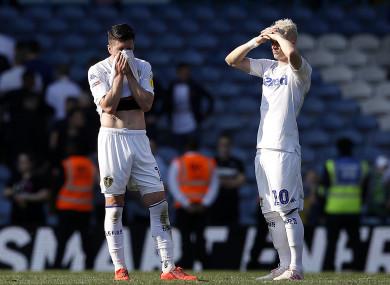 Pablo Hernandez and Ezgjan Alioski dejected after full-time.