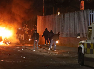 Petrol bombs are thrown at police in Creggan, Derry, last night.