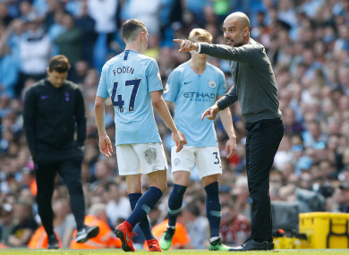 Guardiola speaks with Phil Foden at the Etihad.