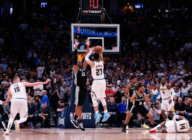 Jamal Murray attempts a shot over San Antonio Spurs center LaMarcus Aldridge.