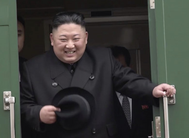 North Korean leader Kim Jong Un smiles as he leaves Khasan train station in Primorye region, Russia