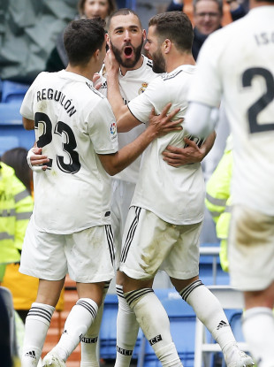 Real Madrid's Karim Benzema, centre, celebrates.