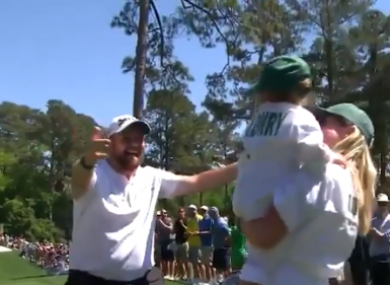 Shane Lowry celebrates with his daughter Iris and wife Wendy.