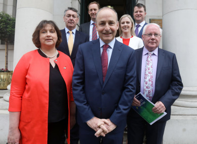 Party leader Micheál Martin with candidates Billy Kelleher (yellow tie), Brendan Smith (front right),  Barry Andrews (back left), Anne Rabbitte (left front) and Malcolm Byrne (purple tie).