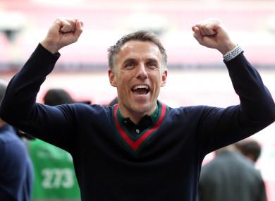 Phil Neville celebrates Salford City's victory.