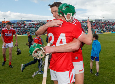 Alan Cadogan (24) with Aidan Walsh after yesterday's game.