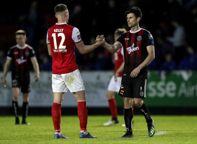 St. Patrick's Athletic's Ciaran Kelly shakes hands with Bohemians' Dinny Corcoran after the game.