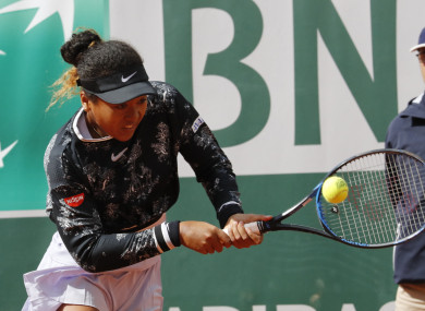 Japan's Naomi Osaka battled back from the brink to avoid defeat at the French Open.