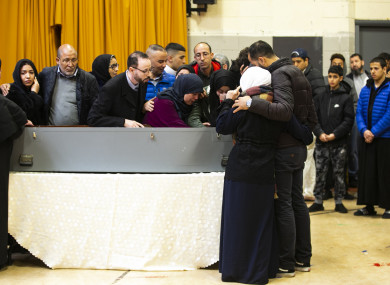 The parents of Azzam Raguragui at his coffin in the Islamic Cultural Centre in Dublin today.