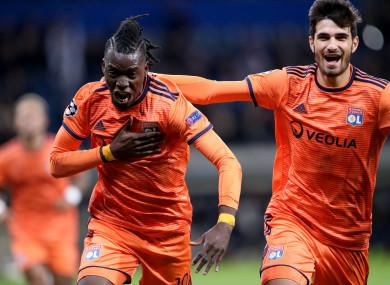 Lyon players celebrate.