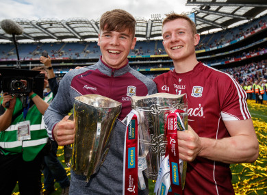 Joe and Jack Canning after Galway's famous All-Ireland double in 2017.