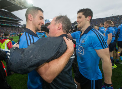 Jim Gavin celebrates the 2015 All-Ireland with James McCarthy and Rory O'Carroll.