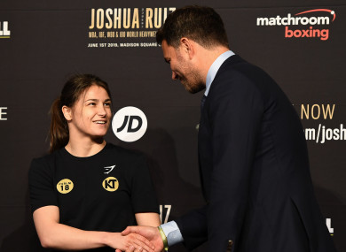 Katie Taylor and Eddie Hearn shake hands during Wednesday's press conference in New York.