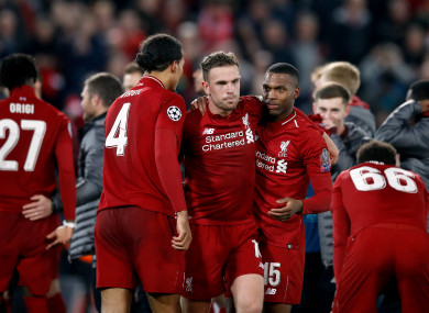 Liverpool's Virgil van Dijk (left), Jordan Henderson (centre) and Daniel Sturridge (right) celebrate after the final whistle.