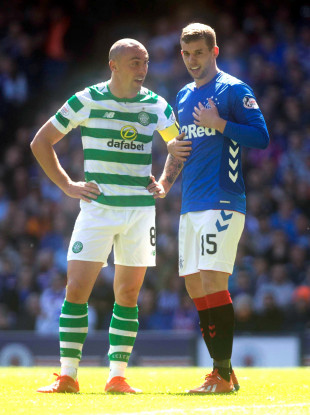 Rangers Jon Flanagan (right) and Celtic's Scott Brown (left) exchange words during the Ladbrokes Scottish Premiership match at Ibrox Stadium.