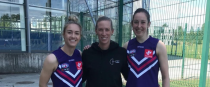 Louth's Kate Flood (left) and Leitrim's Áine Tighe (right) with CrossCoders co-founder and Western Bulldogs star Lauren Spark.