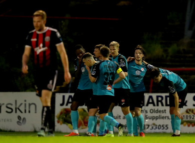 Sligo Rovers' players celebrate Parkes winning goal at Dalymount Park.