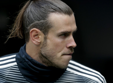 Gareth Bale watches from the bench during Real Madrid's defeat to Real Betis this afternoon.