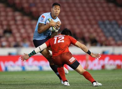 Folau tackled by Harumichi Tatekawa in March.