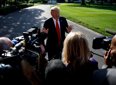 Donald Trump speaks to reporters before leaving the White House in Washington, yesterday.