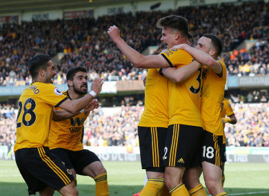 Wolves players celebrate the winning goal.