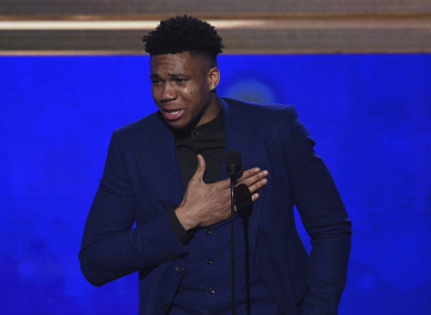 NBA player Giannis Antetokounmpo, of the Milwaukee Bucks, reacts as he accepts the most valuable player award.