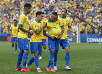Brazil's Everton, with the ball under his jersey, after he scored his side's third goal.