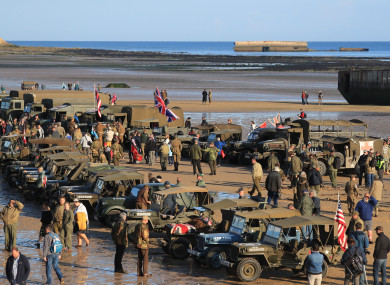 Military vehicles line the beach at Arromanches in Normandy, northern France, ahead of today's ceremony.