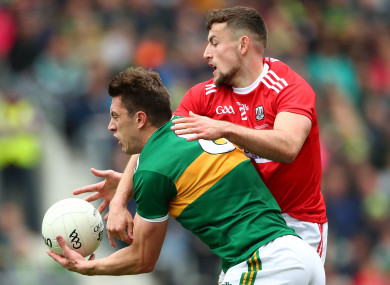 Cork's Nathan Walsh and Kerry's David Moran.