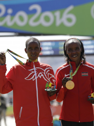 Rio silver medalist Eunice Jepkirui Kirwa, of Bahrain, left, and gold medalist Jemima Jelagat Sumgong of Kenya, have both received lengthy bans for doping.