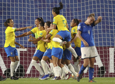 Marta celebrates with her team-mates after becoming the top scorer in World Cup history.
