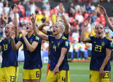 The Swedish players celebrate their remarkable upset.