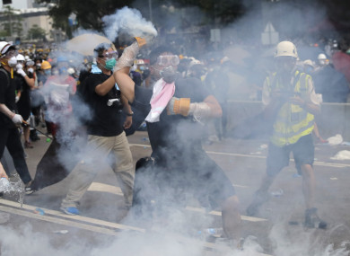 Protestors fire tear gas back at police