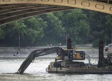 A power shovel fixed onto a pontoon works in Danube river near Margaret Bridge, the scene of tragedy